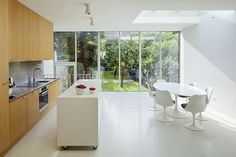 Gorgeous modern kitchen and dining area with Tulip table and chairs