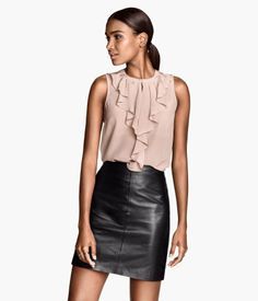 PREMIUM QUALITY. Sleeveless, fitted blouse in silk with ruffles and keyhole opening at front. Fastens with concealed button at neck. ONLINE EXCLUSIVE from H&M