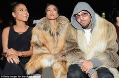 Trying to hide? The entertainer covered up with a heather grey hoodie and purple-tinted sh...