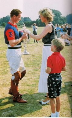August 6 1989 Diana presents the Captains' and Subalterns' Cup to James Hewitt after a Polo Match at Tidworth in Wiltshire, while William looks on