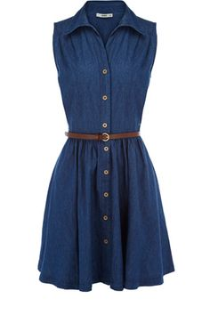 This classic shirt dress has buttons down the front and a belt to fasten the waist. With a cute collar to finish, this piece is sleeveless in style and comes in a denim material.