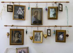 hang vintage pics and decor from curtain rods & brackets on a wall for a shabby chic display