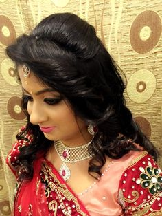 Indian bride's bridal reception hair. Hairstyle by Swank Studio. Find us at https://www.facebook.com/SwankStudioBangalore   #Saree #Blouse #Design #HairAccessory