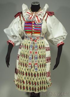 Includes: black velvet jacket with floral trim and antique plastic buttons with floral motifs; pleated black cotton skirt with matching floral ribbon; embroidered pleated black cotton apron with floral trim along the edges; Black Velvet Jacket, Floral Ribbon, Tribal Dress, Folk Embroidery, Wedding Costumes, Folk Costume, Cotton Skirt, Festival Wear, Embroidered Blouse