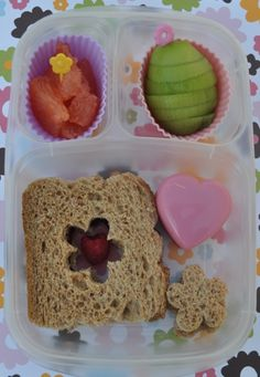 Spring lunch box in a hurry. A little flower cut out makes the sandwich oh so pretty!