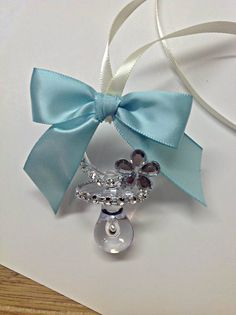 12 pcs Baby Shower Pacifier Necklace Tiff. Blue and Diamond inspired theme, Personalized! by AVAandCOMPANY on Etsy https://www.etsy.com/listing/166232693/12-pcs-baby-shower-pacifier-necklace