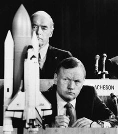 In this Feb. 11, 1986 file photo, former astronaut Neil Armstrong, a member of the presidential panel investigating the Space Shuttle Challenger explosion, listens to testimony before the commission in Washington, as David Acheson, a commission member, listens in the background. A model of the shuttle sits on the table.