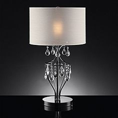 @Overstock.com - Elena Refined Crystal Table Lamp - Brighten any space in your home with this gorgeous crystal table lamp. This beautiful table lamp will add a touch of elegance to any room with its black, chrome finish and stunning crystal droplets that surround this fixture to reflect the light.  http://www.overstock.com/Home-Garden/Elena-Refined-Crystal-Table-Lamp/6643835/product.html?CID=214117 $102.59
