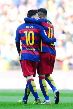 Lionel Messi of FC Barcelona celebrates with his teammate Neymar after scoring his team's fourth goal during the La Liga match between FC Barcelona and Getafe CF at Camp Nou on March 12, 2016 in Barcelona