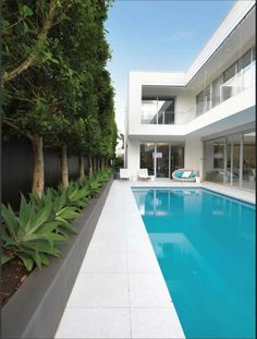 Stock Tank Swimming Pool Ideas, Get Swimming pool designs featuring new swimming pool ideas like glass wall swimming pools, infinity swimming pools, indoor pools and Mid Century Modern Pools. Find and save ideas about Swimming pool designs. Backyard Pool Landscaping, Swimming Pools Backyard, Swimming Pool Designs, Indoor Pools, Pool Fence, Backyard Ideas, Plants Around Pool, Pool Plants, House Plants