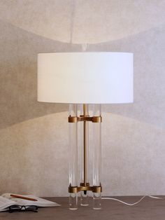 Trinsal Table Lamp - Brass accents add a soft elegance to the Trinsal, delicately ascending the glass frame and gently glimmering in the lamp light. Luxury Lighting, Lighting Store, Outdoor Lighting, Decoration Lights For Home, Light Decorations, Luxury Table Lamps, Brass Table Lamps, Wall Lights, Ceiling Lights