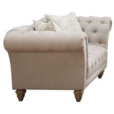 Add a lovely touch to your living room or den with this chic loveseat, showcasing diamond-tufted upholstery and nailhead trim.