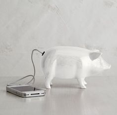 how cute is this little piggy?! he's an iphone speaker! LOVE.     via @MatchbookMag