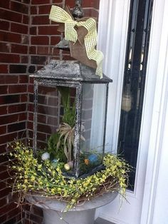 Add a bunny, ribbon and spring wreath to any lantern for a quick and Easter Welcome!