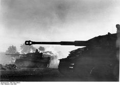 German Panzer VI/Tiger I tanks passing burning buildings during the Battle of Kursk in Orel Russia July 1943.
