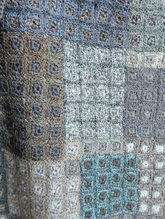 """Intricate square within square patchwork pattern in the latest palette of blues and neutrals. 12 x 50 inches, hand crocheted """"Biome"""" scarf by Sophie Digard."""