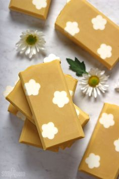Learn how to make handmade Daisy Cold Process Soap! This tutorial uses daisy embeds to create flower shapes, and has a sophisticated floral scent.