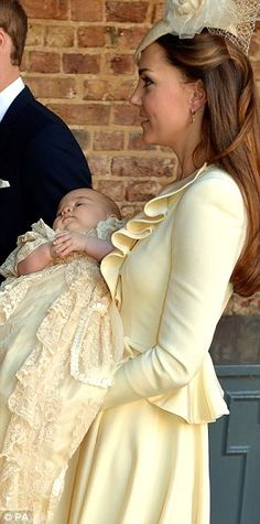 The Duchess of Cambridge carries her son Prince George alongside the Duke of Cambridge, following the christening of the Prince at the Chapel Royal in St James's Palace by the Archbishop of Canterbury in central London