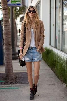Miami Art Basel 2012 Street Style - A rich camel blazer perfectly juxtaposes distressed denim shorts.