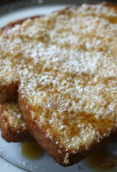 Baked Coconut French Toast is a coconut lover's breakfast! A sweetened coconut egg mixture is poured over bread then baked till nicely toasted. Waffle Recipes, Brunch Recipes, Breakfast Recipes, Brunch Dishes, Breakfast Ideas, Coconut Recipes, Baking Recipes, Sweets Recipes, Bread Recipes