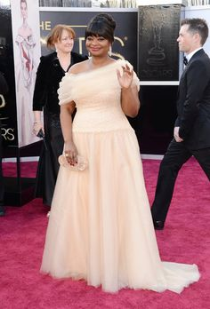 Best Oscars Dresses 2013: Octavia Spencer showed her loyalty to Tadashi Shoji in an asymmetrical, full skirted gown from the label.