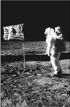 U.S. astronaut Buzz Aldrin stands on the moons surface. There, the astronauts placed a special mirror designed to reflect back a laser beam sent from Earth.