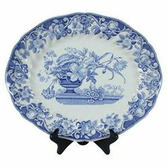 """Vintage Royal Doulton Pomeroy porcelain serving platter with a blue floral motif. Made in England.   Product: Serving platterConstruction Material: Porcelain Color: Blue and white  Features:  Made in EnglandStand not included   Dimensions: 12.5"""" H x 15"""" W x 1"""" DNote: Due to the vintage nature of this product, some wear and tear is to be expected. Products may show signs of brand marks, scrapes or other blemishes."""