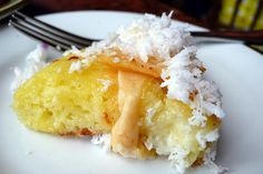 https://flic.kr/p/yrkit | via mare bibingka slice | a rice flour-based cake baked in a clay oven, topped with quesong puti (a mild white cheese) and queso de bola (edam cheese). served with a generous blob of butter because apparently cheese isn't enough dairy, and um, lots of freshly grated coconut to cut through the fat.