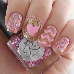 Pretty in pink and gold, glitter nail art design with gold glitter zigzag details and baby pink base coat.