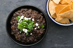 Black beans, cooked and then fried and mashed with onion, garlic, chili, and cilantro. So good!!