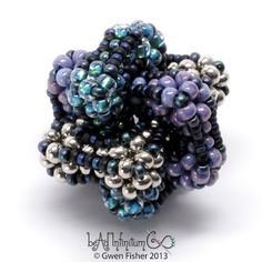 """""""Borromean beaded bead"""" with three intertwined cubic RAW components, by gwenbeads"""