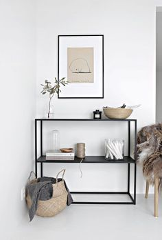 You know when you have those unique spaces of your home that are downright tricky to decorate? By taking inspiration from this trendy design, you can't go wrong with a modern black metal bookshelf and minimalist accessories!