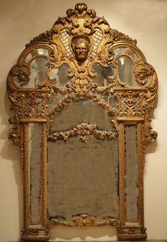 Very fine and unusual Regence carved and gildet mirror with original gilding, France, attributed to Bernard Toro, 102,9 x 116,8 cm