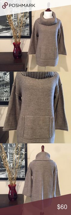 J. Crew Amade Sweater J. Crew Amade Sweater. Perfect sweater for fall and winter. Soft brown color. Oversized with large cowl neck, 3/4 length sleeves. Front pocket. 50% acrylic, 40% wool, 10% mohair. Excellent condition. No pilling, pulls, holes. Size small. J. Crew Sweaters