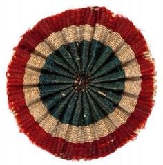 Cockade: A rosette or similar ornament worn on the side of the hat.