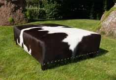 A classic chocolate and white cowhide ottoman with studs by Gorgeous Creatures who are a cowhide ottoman and leather decor specialists. www.gorgeouscreatures.co.nz or www.cowhideottoman.com.au