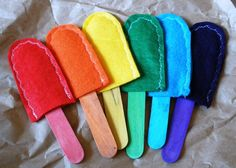 """These felt popsicles are perfect for learning and practicing colors. Each colored stick matches one felt """"popsicle"""". The sticks slide in and out of the bottom of the popsicles. Learning Toys, Early Learning, Preschool Activities, Bible Activities, Learning Colors, Preschool Learning, Teaching, Preschool Colors, Preschool Crafts"""