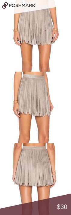 """BB Dakota Pearl Fringe Suede Mini Skirt Toffee 4 🏷 NWT // Shimmy your way into everyone's hearts in the BB Dakota Pearl Taupe Suede Fringe Mini Skirt! Super soft and stretchy microfiber suede begins at a high, banded waist while all-around fringe adorns the sexy bodycon mini skirt. Hidden back zipper with clasp. 15.5"""" in length. 92% Polyester, 8% Spandex. True to size: 4. Purchased new from Revolve Clothing for $70. BB Dakota Skirts Mini"""