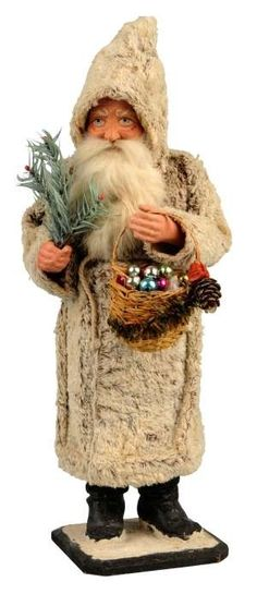 §§§ . Rare Christmas candy container of Santa holding fir tree and carrying basket of ornaments, 15 inches tall, estimate $ 3000-5000.