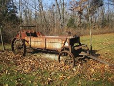 Rusty old manure spreader.