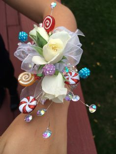 Corsage I made for my son's Candyland themed homecoming dance. Cost $35 for both the corsage and boutonnière, and I got everything at Michaels. Much more fun than the average corsage!