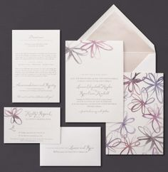 Our Watercolor Blossoms invitation suite is shown here thermograph printed in mushroom ink.