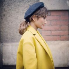 low ponytail and beret