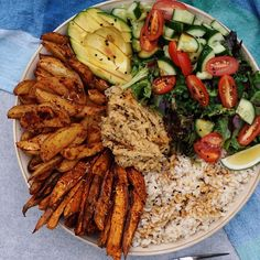 Never too many carbs Brown rice, kale, lettuce, tomato, cucumber, avocado, #oilfree baked paprika & rosemary white potato + sweet potato chips, homemade oil-free hummus and tamari sauce Filmed how i make these chips and will post vid up tomorrow. #vegan #carbaholic Off to the dentist now to get fillings...SO SCARED AH