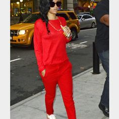 Celebrity inspired Sexy silk red ankle pants.. FMD Sexy red pants by baby phat ankle length zip up the back perfect for the holidays Baby Phat Pants Ankle & Cropped