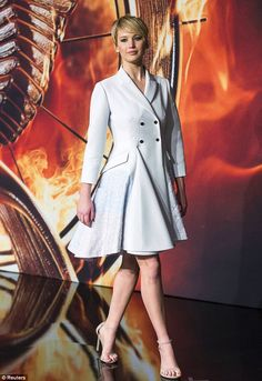 Winter whites: Jennifer Lawrence arrives on the red carpet for the German premier of The Hunger Games: Catching Fire in Berlin on Tuesday, November 12, 2013