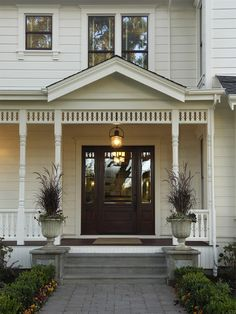 love the front door, I would go more decorative around it.. bigger pots and plants, chairs , anything obnoxiously southern :)