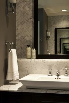 Herringbone tile pattern behind mirror and wall color