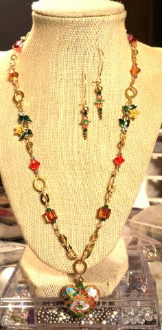 Colorful Swarovski Crystal and Gold Finished Brass Necklace with Flower Links, Hand Painted Floral Heart Pendant Earrings 24 Inch Necklace by FlowerFelicity on Etsy $ 45.99 Created from scratch by hand! https://www.etsy.com/listing/255031716/colorful-swarovski-crystal-and-gold