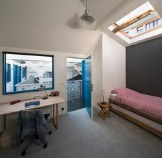 An old two story #carpentry in the heart of #Paris has been converted into a family house by Agnès & Agnès who filled the large space with little pitched boxes scattered on both levels #conversion #bedroom